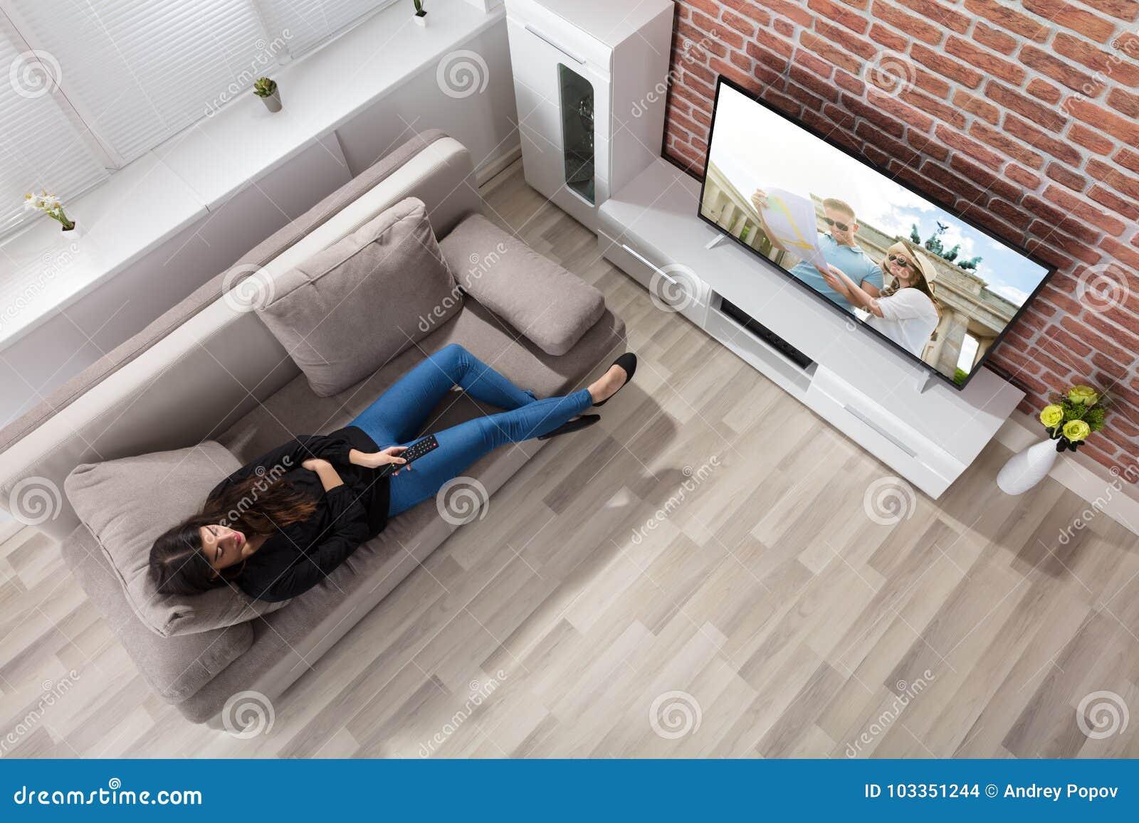 Woman Watching Television At Home