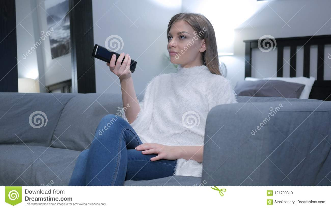 Woman Watching TV, Changing Channels with Remote