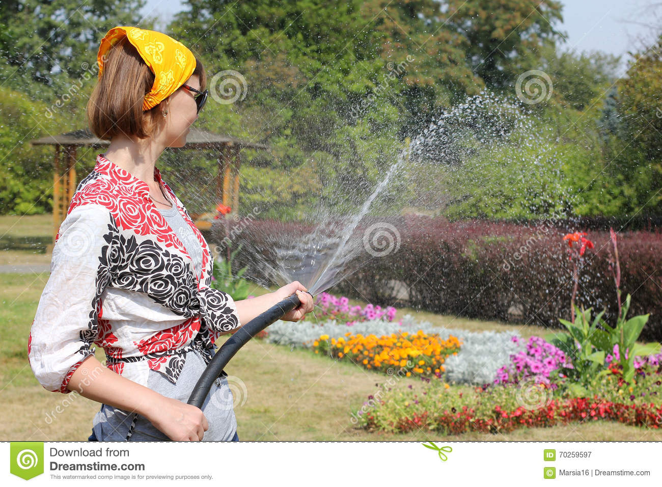 Woman watering the flowers