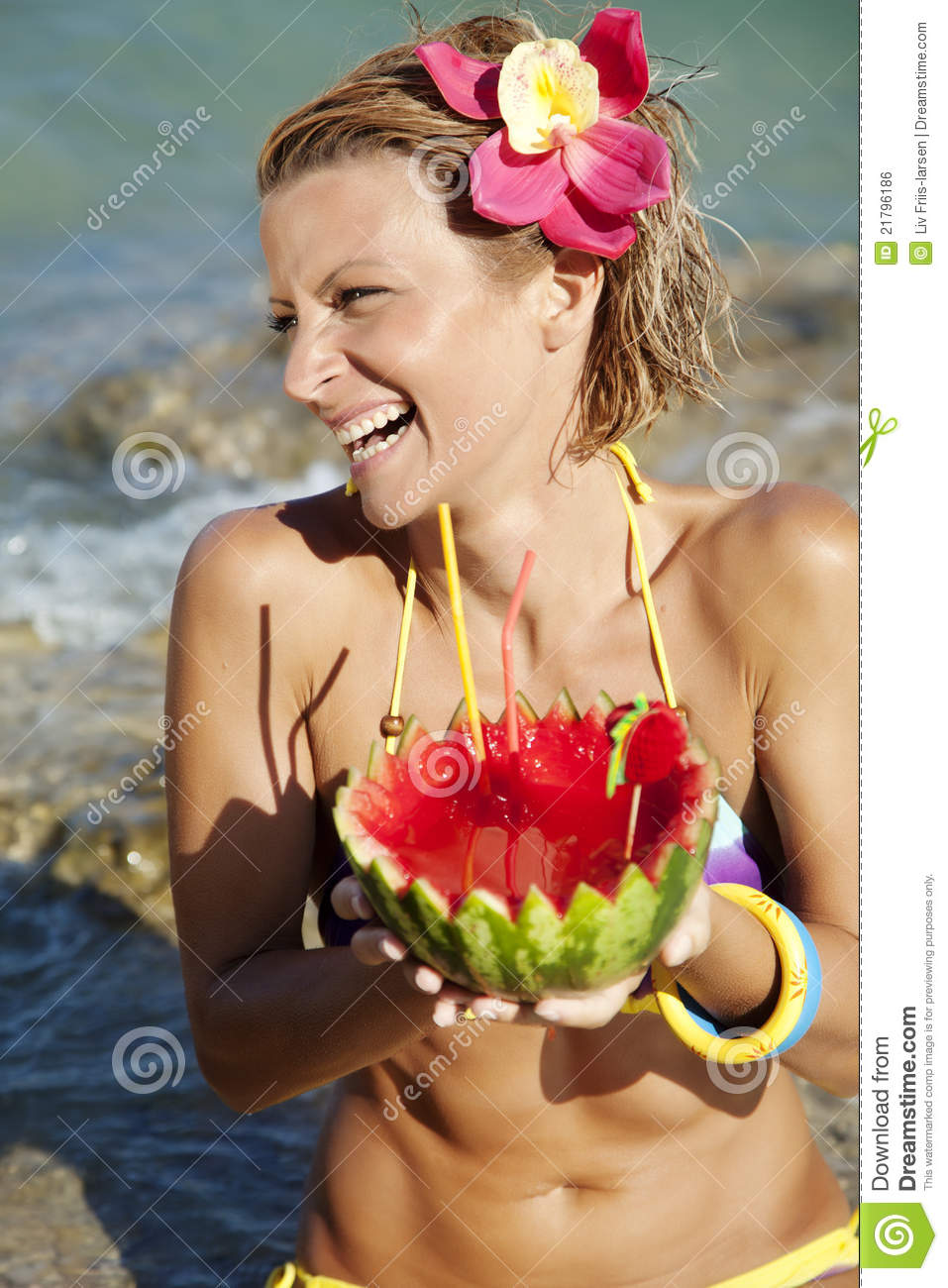 Woman with watermelon cocktail