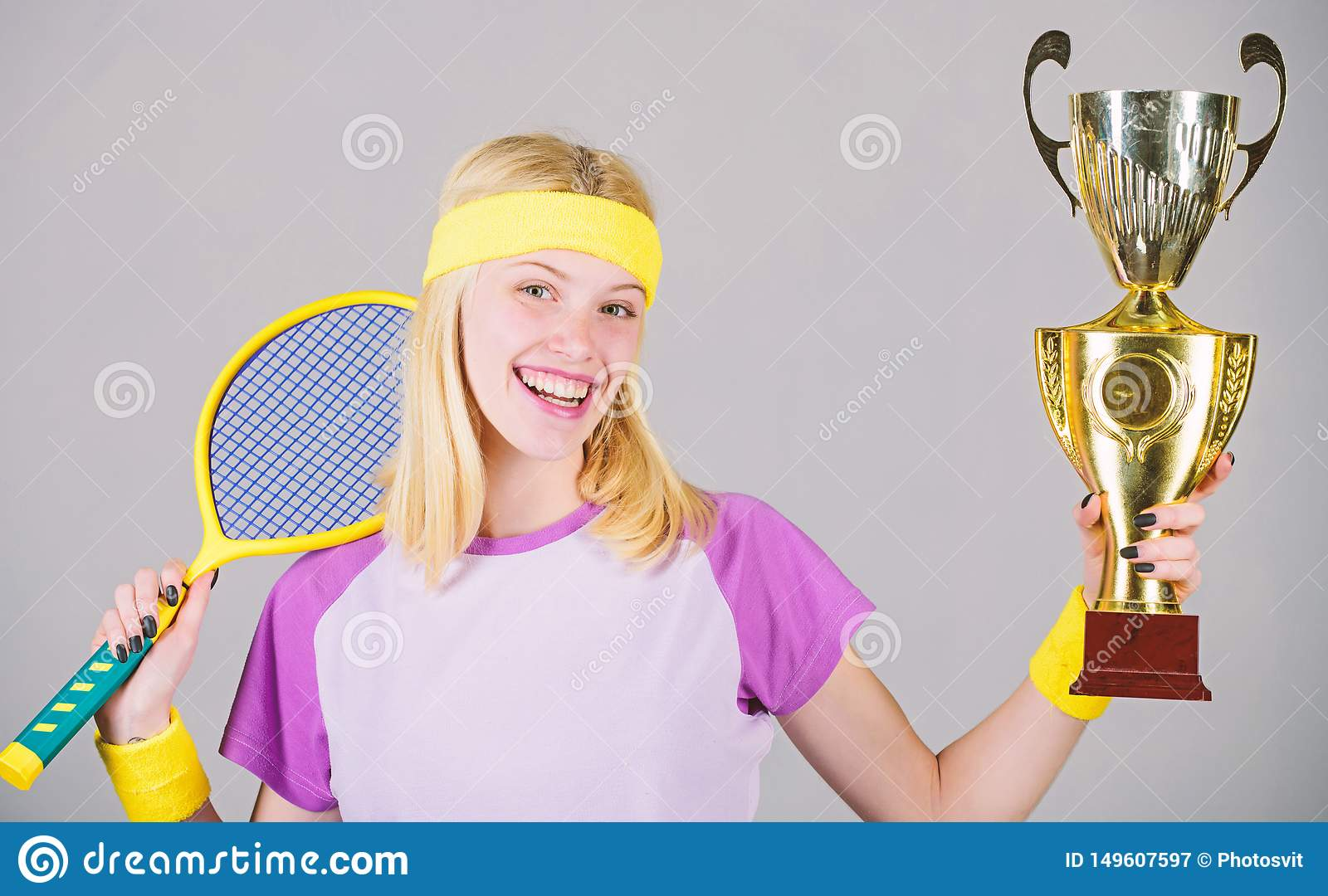 Woman wear sport outfit. First place. Sport achievement. Celebrate victory. Tennis champion. Athletic girl hold tennis
