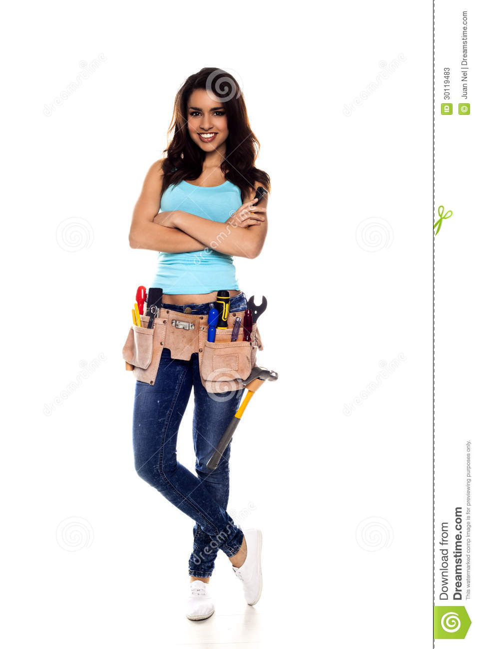 woman wearing a DIY tool belt full of a variety of useful tools on a ...
