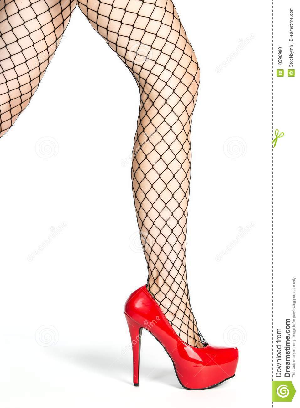 1169586a4 Legs of a woman in shiny red platform high heels shoes and fishnet stockings  PLEASE NOTE  the shoes are a no-name product from a chinese market and no  ...