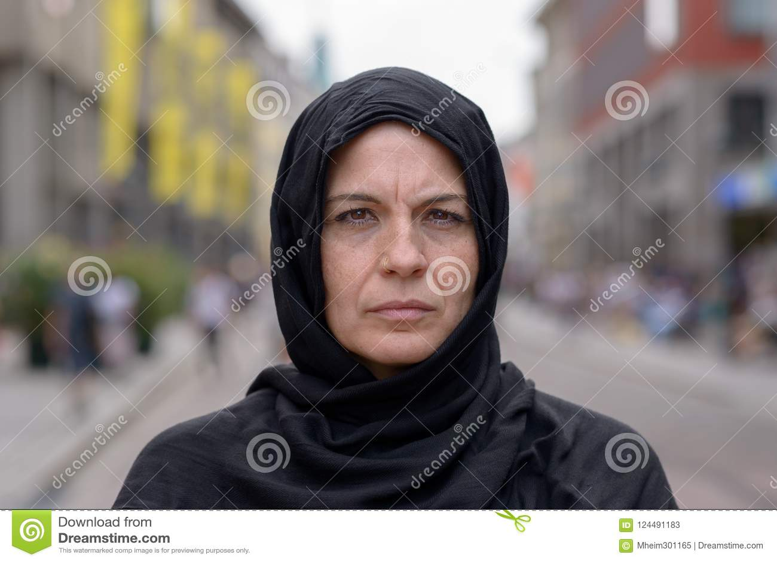 Woman wearing a head scarf in an urban street