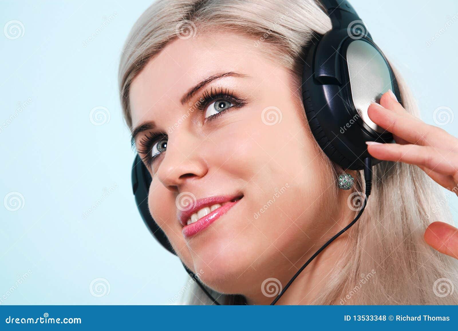 Woman Wearing Headphones Listening To Music Royalty Free ...
