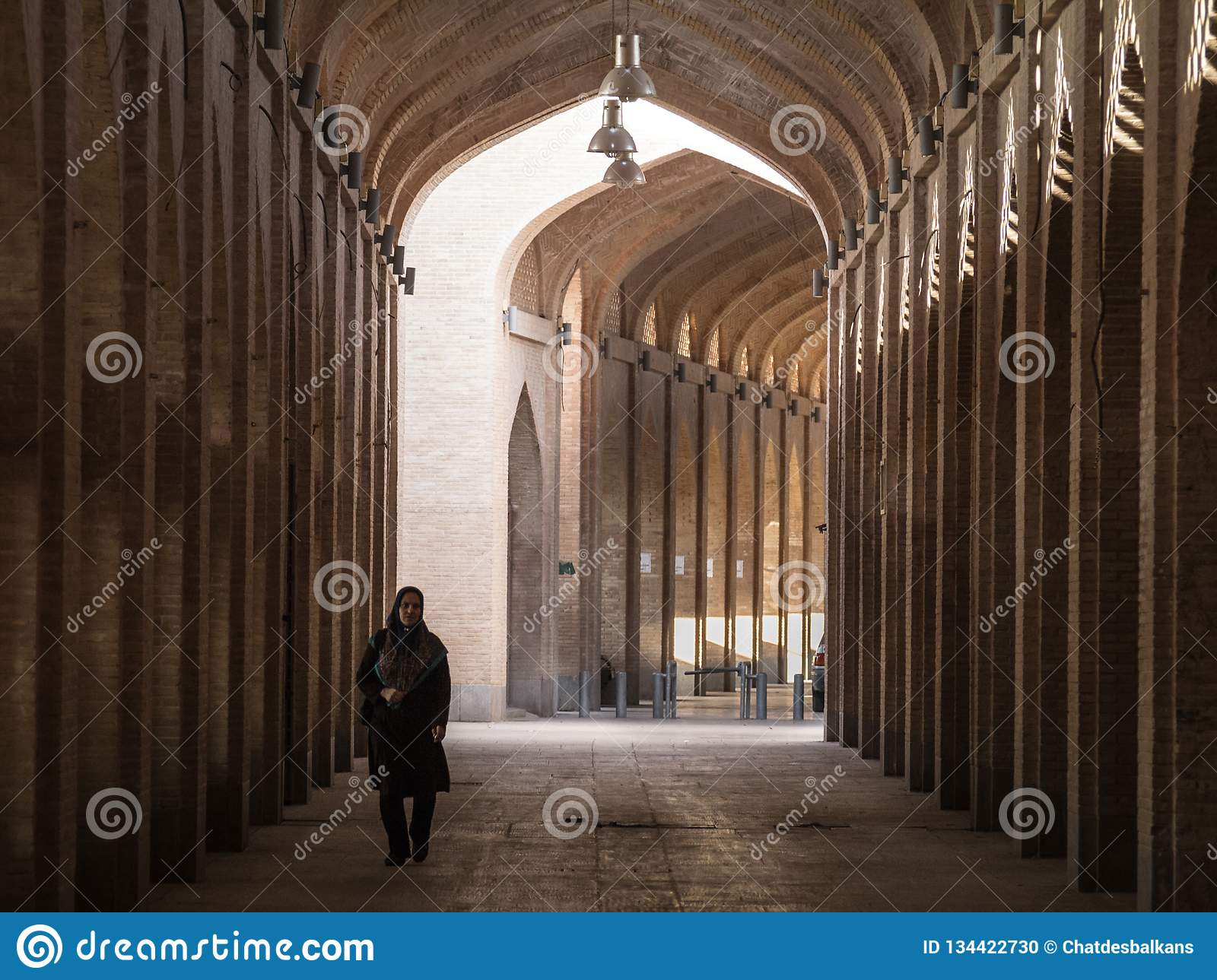 c8f3ee828275 Woman Wearing The Islamic Veil Walking In A Street Of The Covered ...