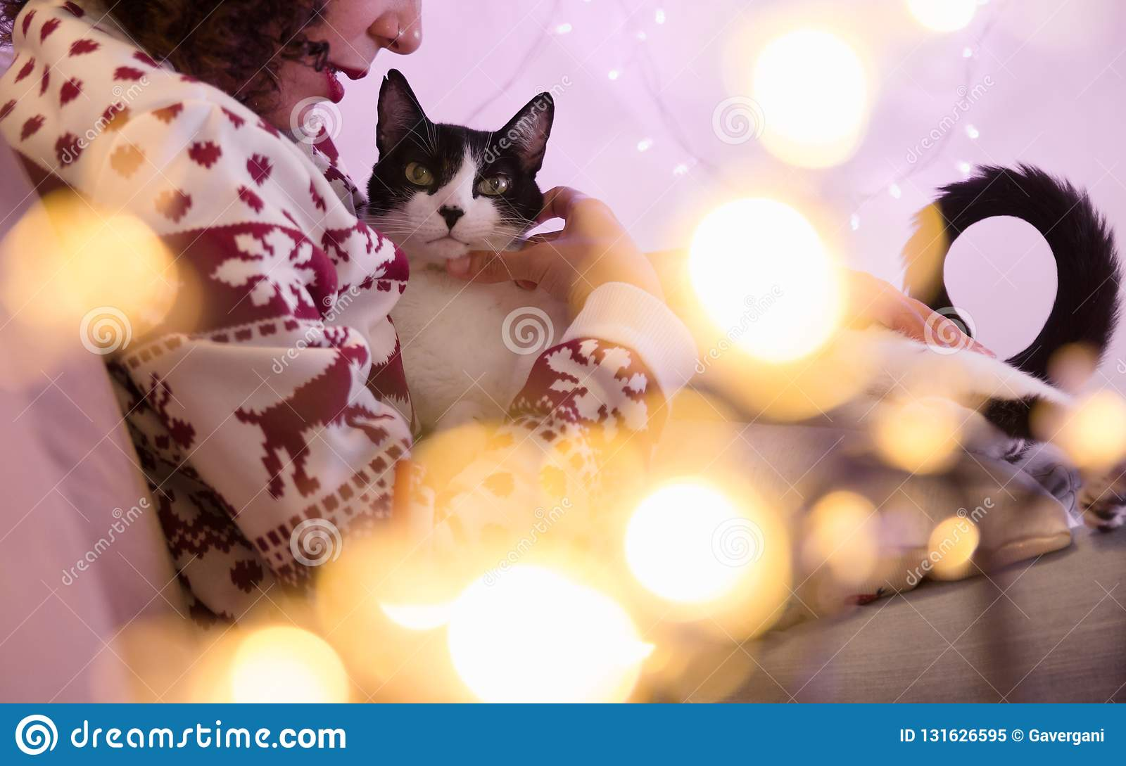 Woman Wearing Santa Hat And Christmas Sweater And Adorable Pet Cat ...