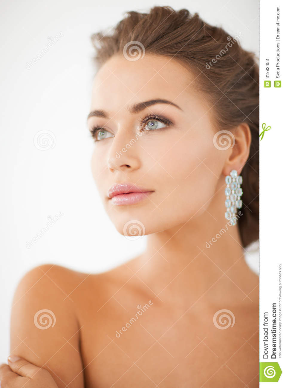 Cool Woman Wearing Shiny Diamond Earrings Royalty Free Stock