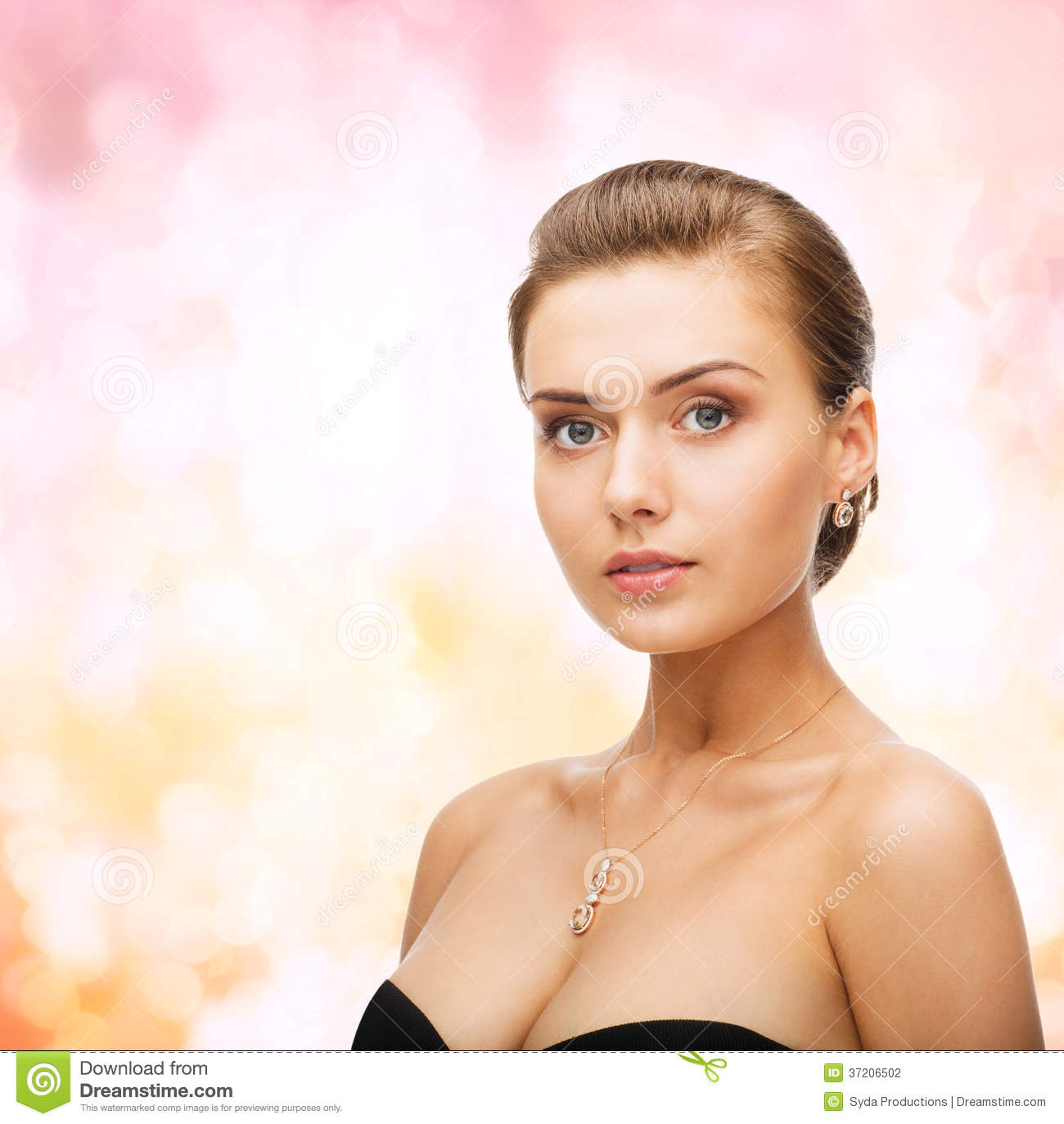 Woman wearing shiny diamond earrings and pendant stock photo royalty free stock photo aloadofball Image collections