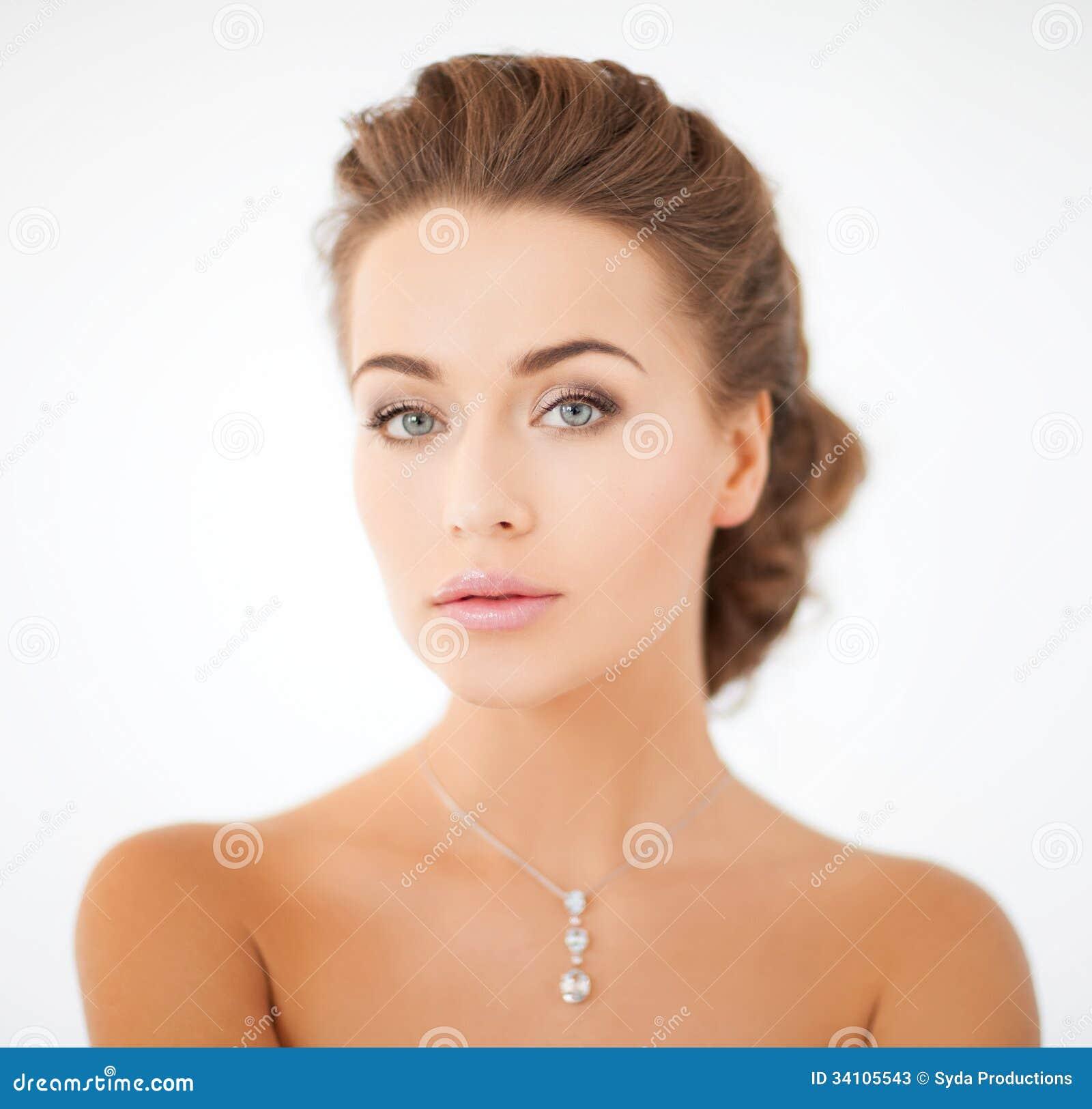 Woman wearing shiny diamond pendant stock image image of woman wearing shiny diamond pendant stock image image of advertisement luxuries 34105543 aloadofball Gallery