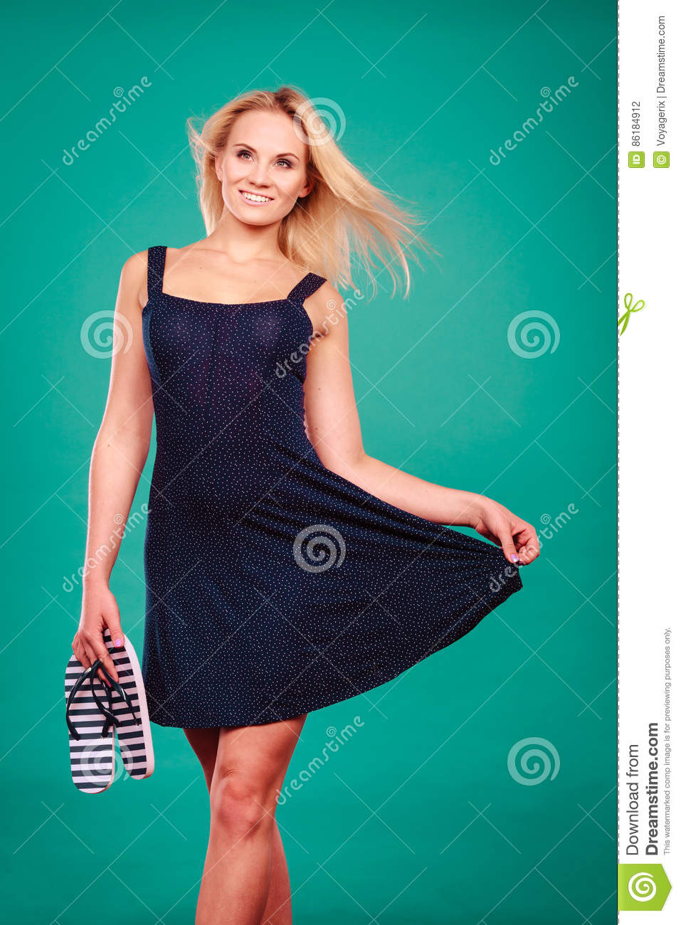 6b1747907e70 Summer trendy fashionable outfit ideas concept. Woman wearing short navy  dress holding flip flops. More similar stock images