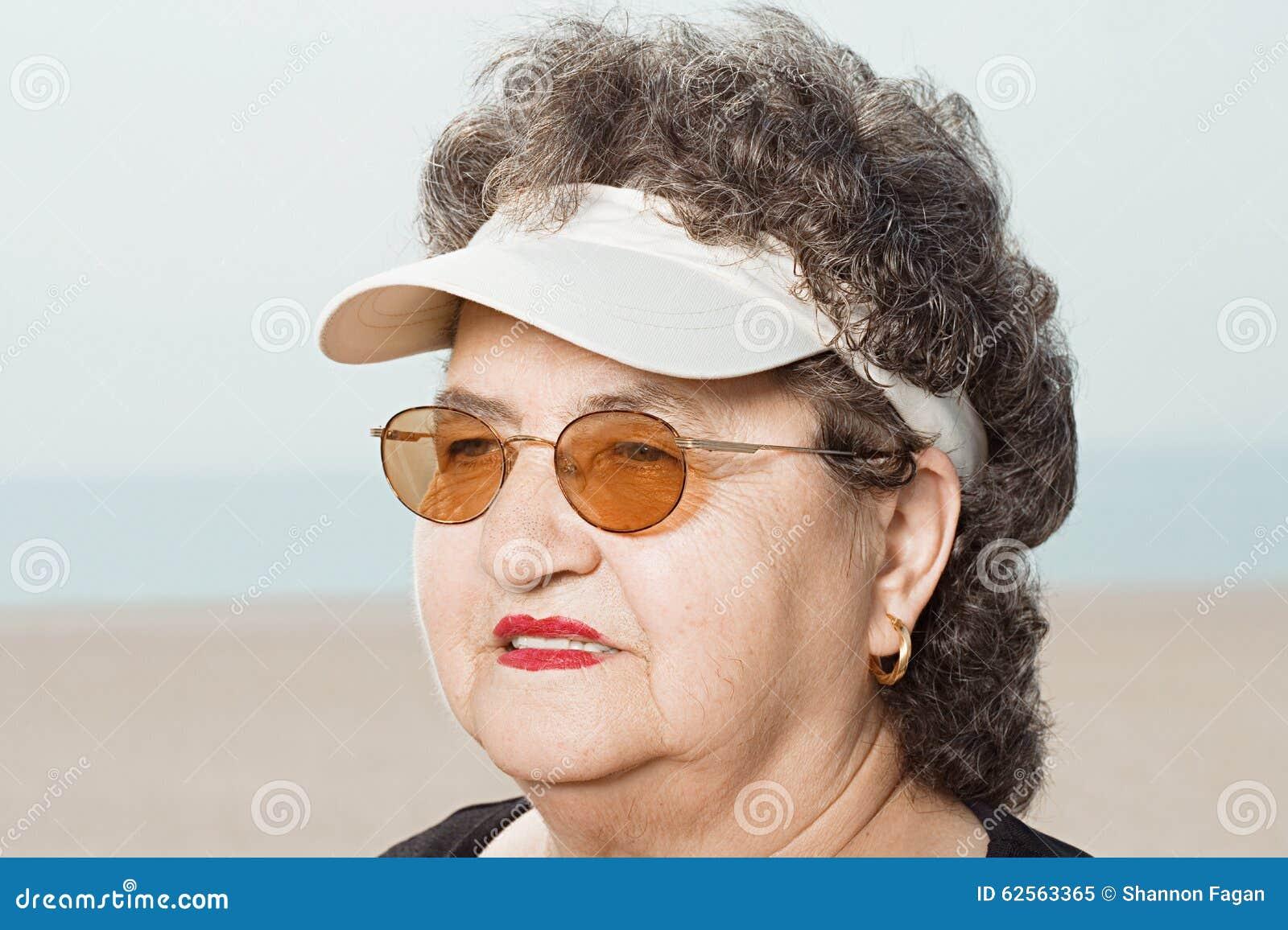 c8e9cb48 Woman wearing a sun visor stock image. Image of looking - 62563365