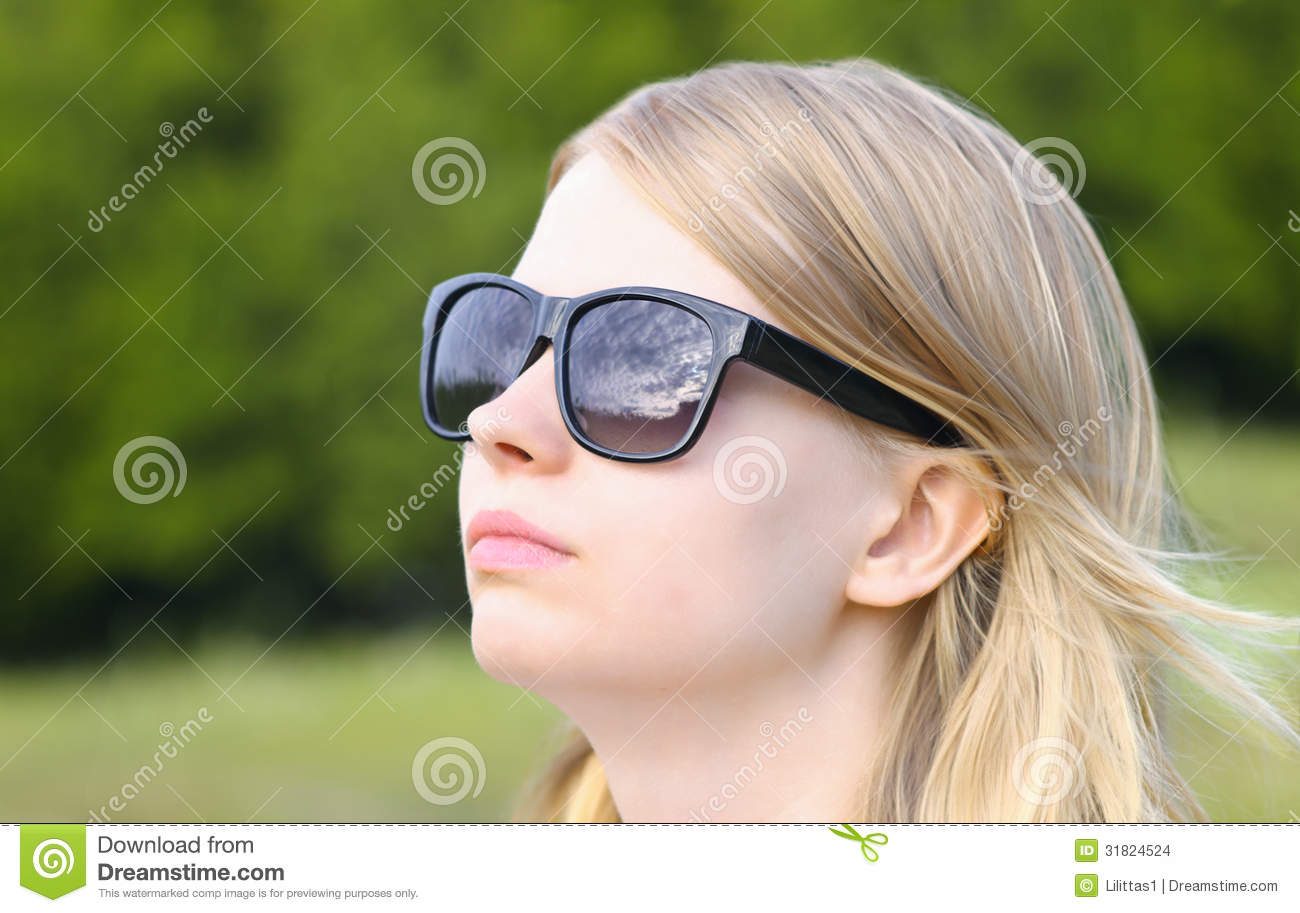 Woman Wearing Sunglasses With Sky Mirroring Stock Images
