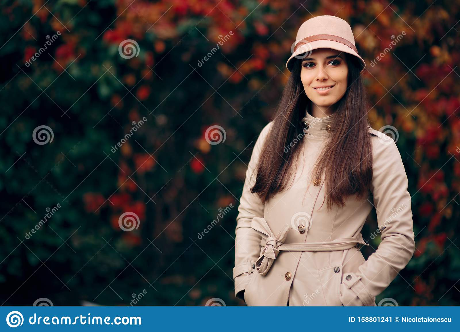 Woman Wearing Trench Coat and a Hat Fashion Portrait