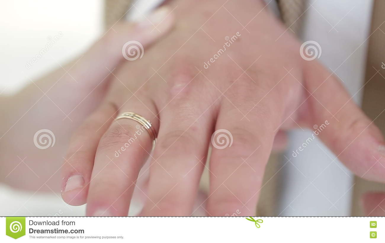 Woman Wears Wedding Ring On The Hand Of The Man Stock Footage