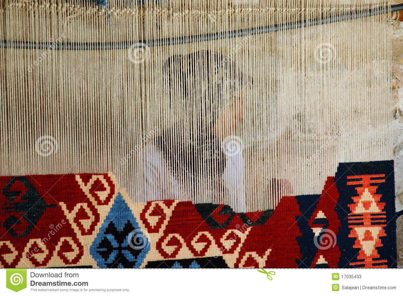 Woman Weaving A Traditional Turkish Carpet In Gor