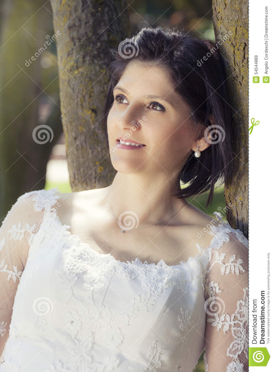 Woman in wedding white dress outdoors