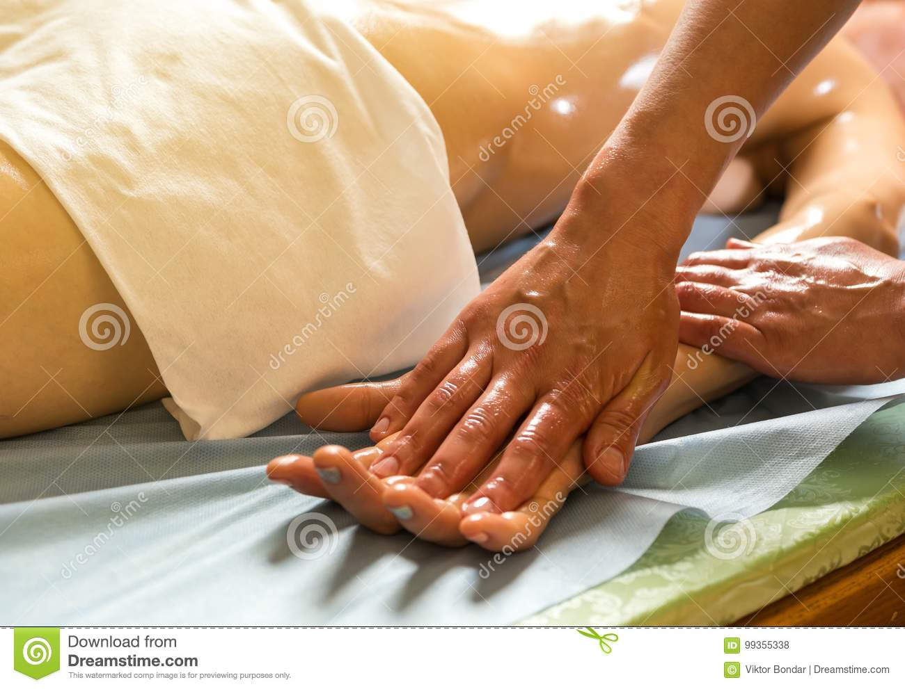 Woman in wellness beauty spa having aroma therapy massage with e