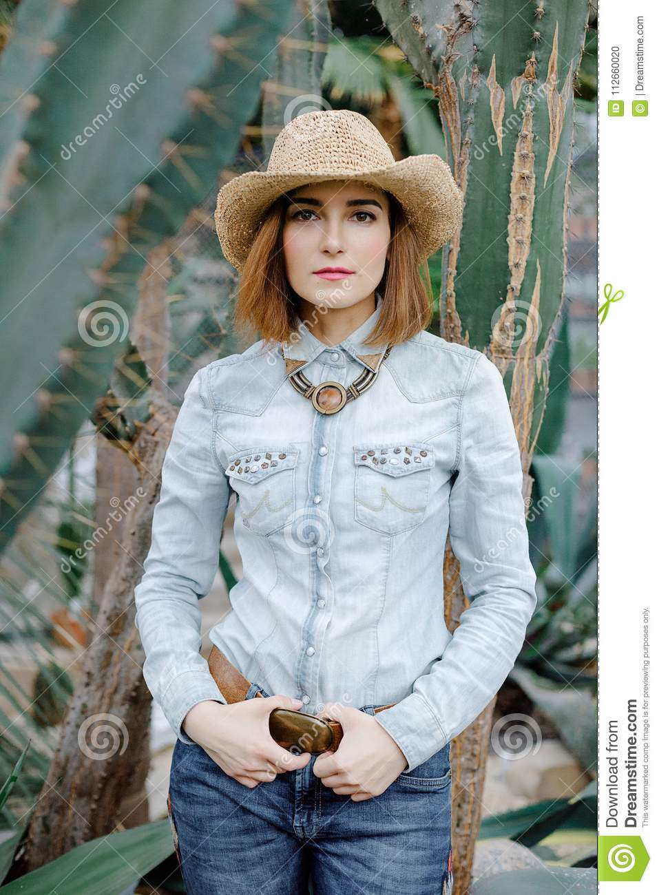 Woman In Western Wear In Cowboy Hat Jeans And Cowboy Boots Stock