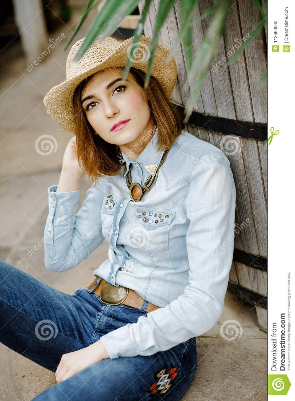 3767bf2e8bf8 Woman In Western Wear In Cowboy Hat