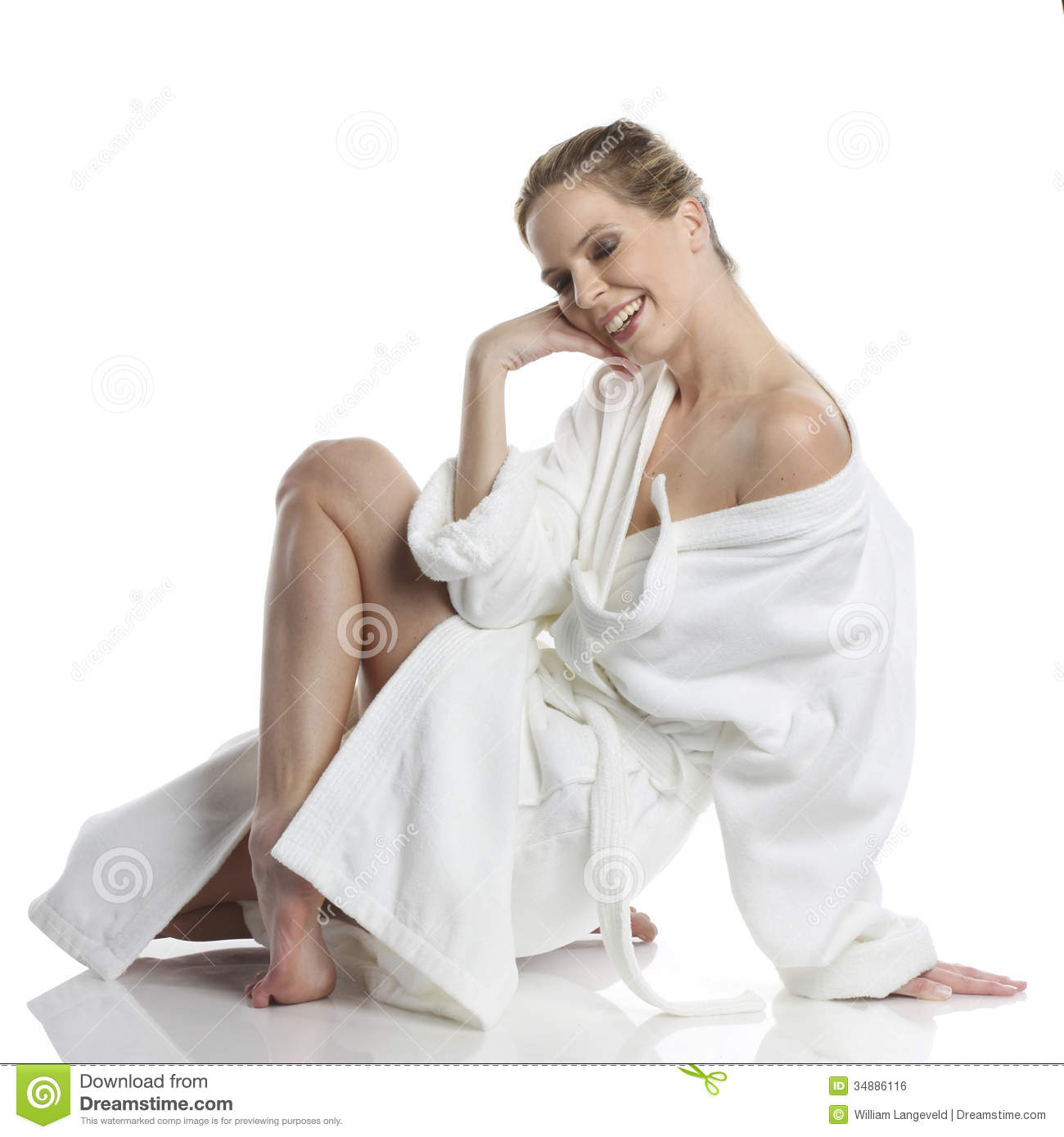 Very beautiful woman dressed in a white bathrobe in wellness style 23272b7cc