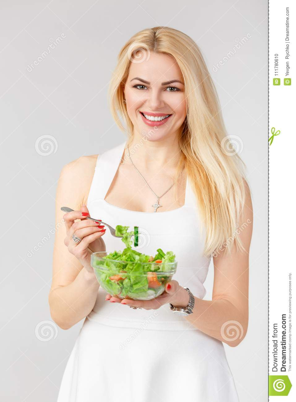 Woman in white dress with fresh salad