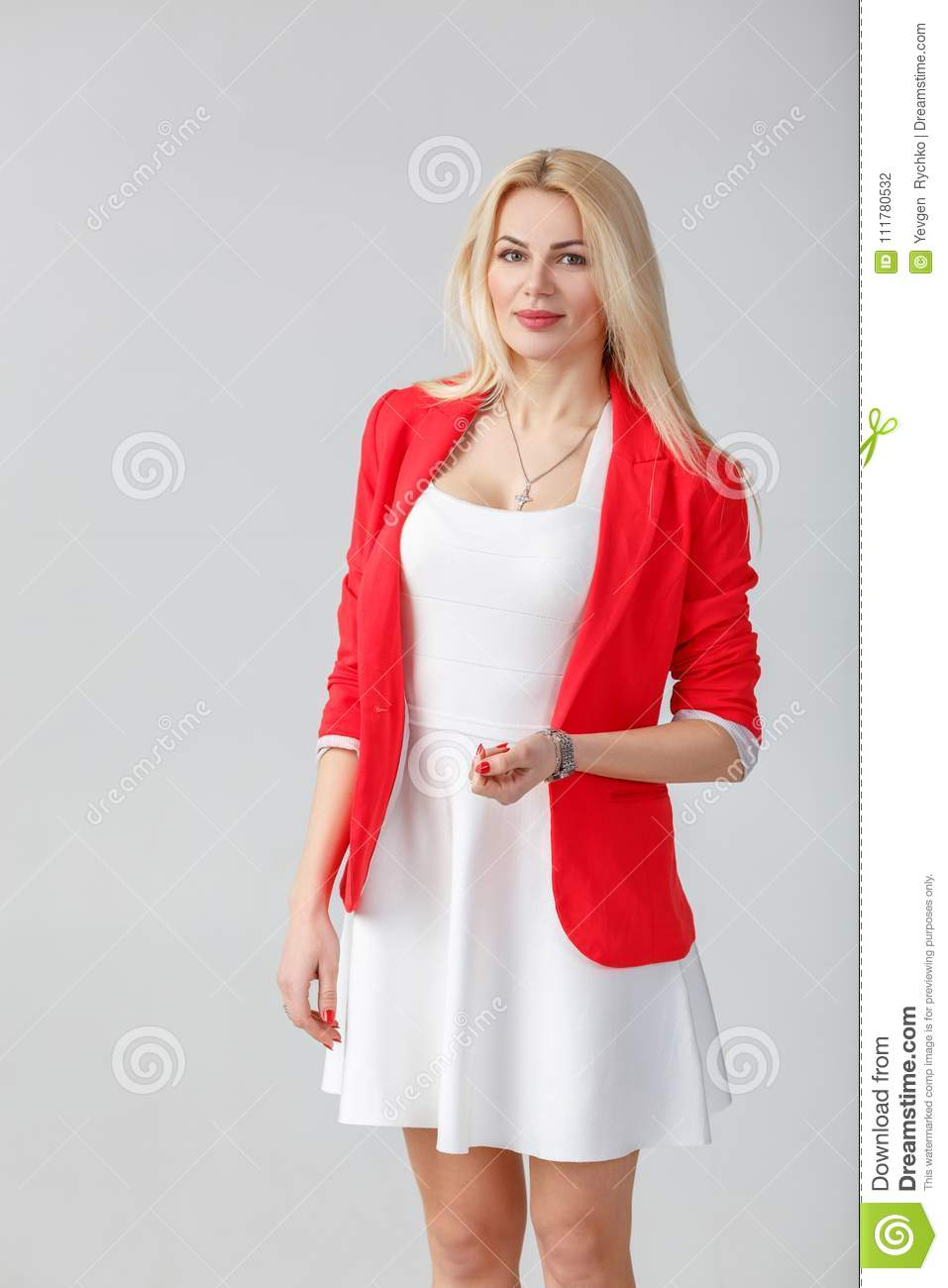 Woman in white dress and red jacket
