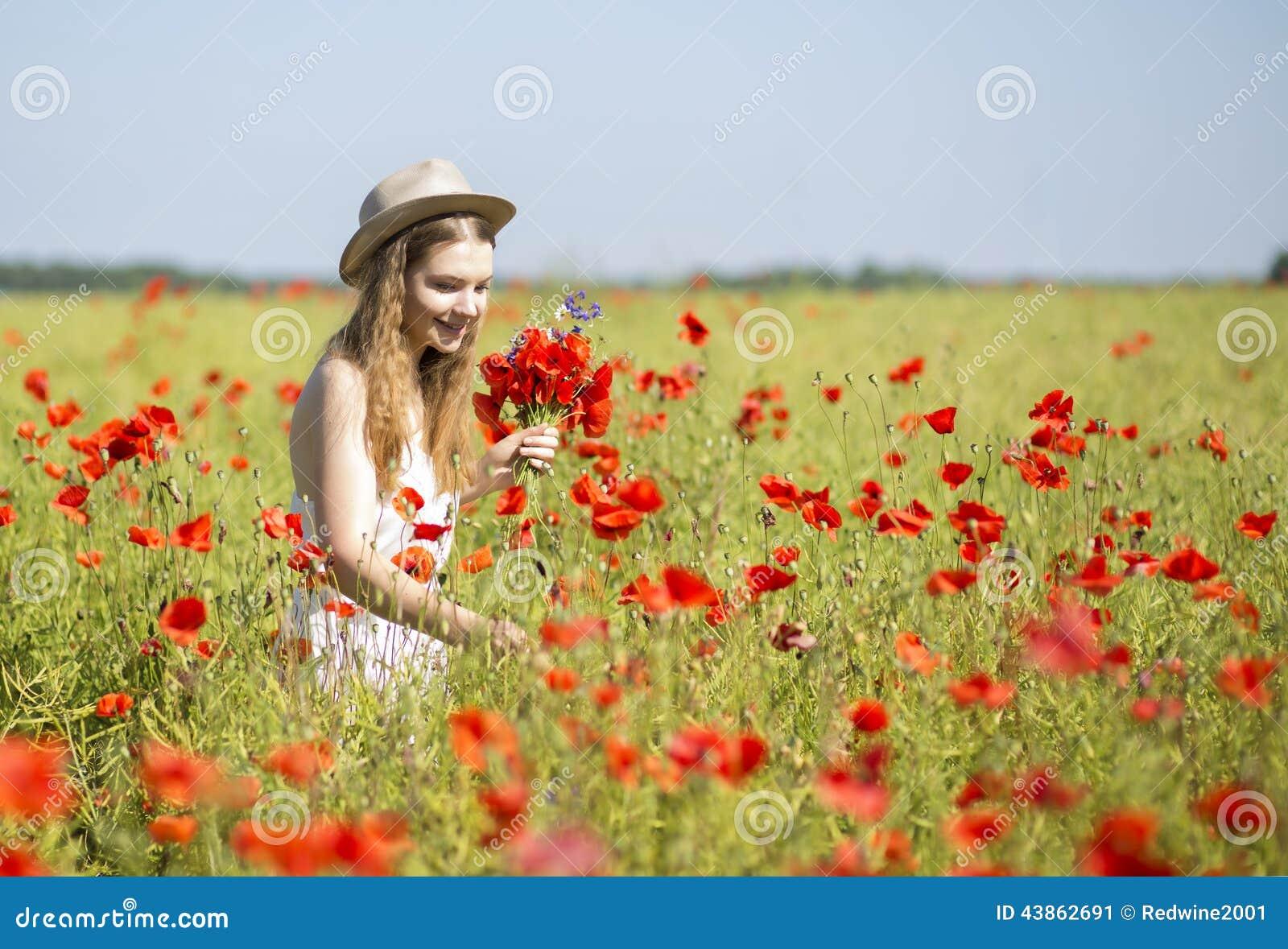 Woman at white dress search beatiful flower