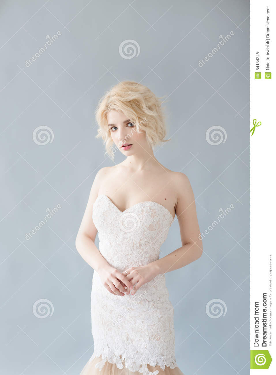 woman with white hair in a wedding dress. young blonde woman with