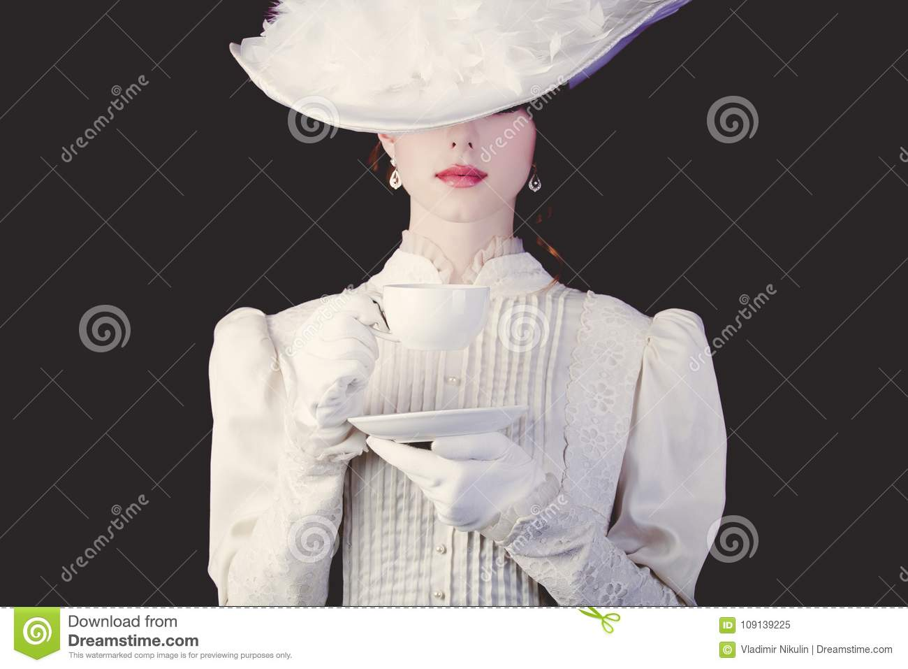 Woman in white Victorian era clothes with cup of tea