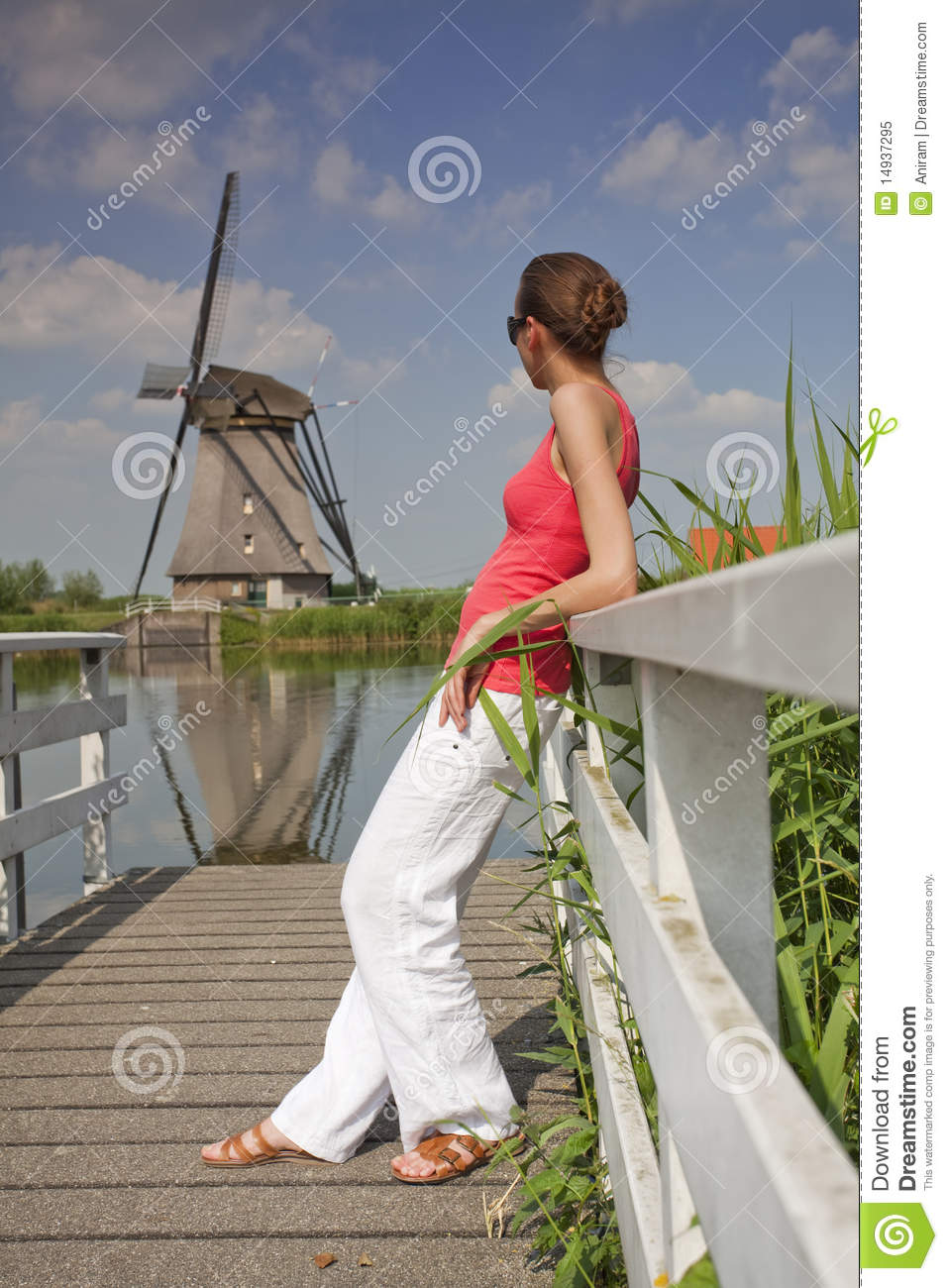 woman and windmill royalty free stock photo