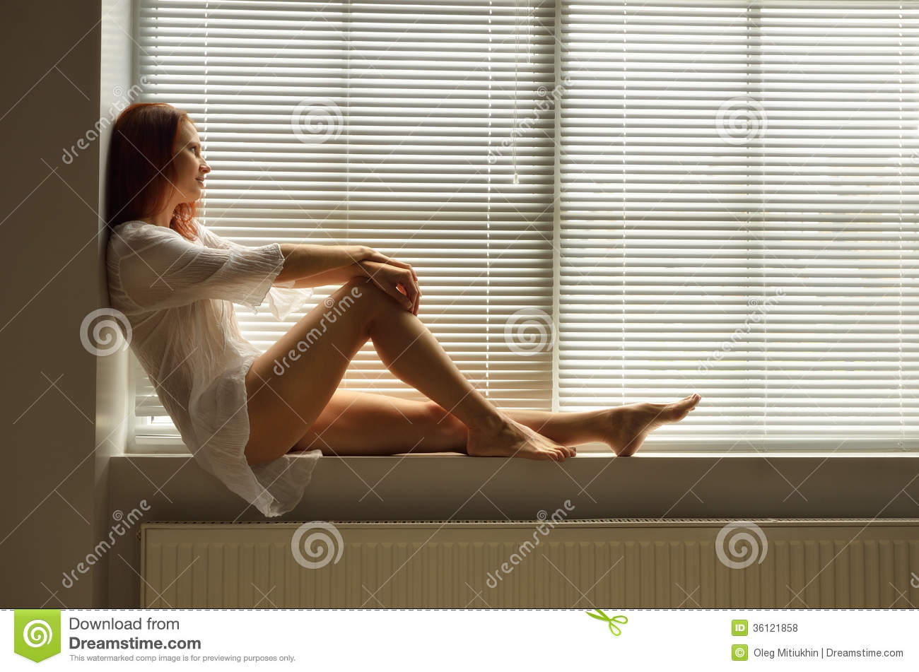 A woman on the windowsill at home