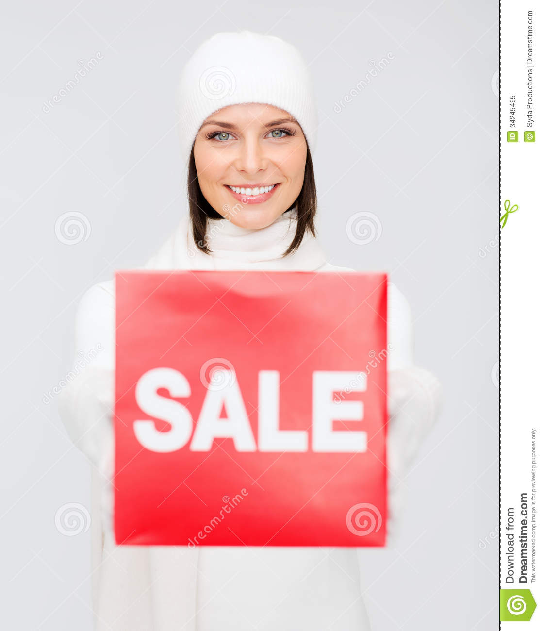 Woman In Winter Clothes With Red Sale Sign Stock Image ...