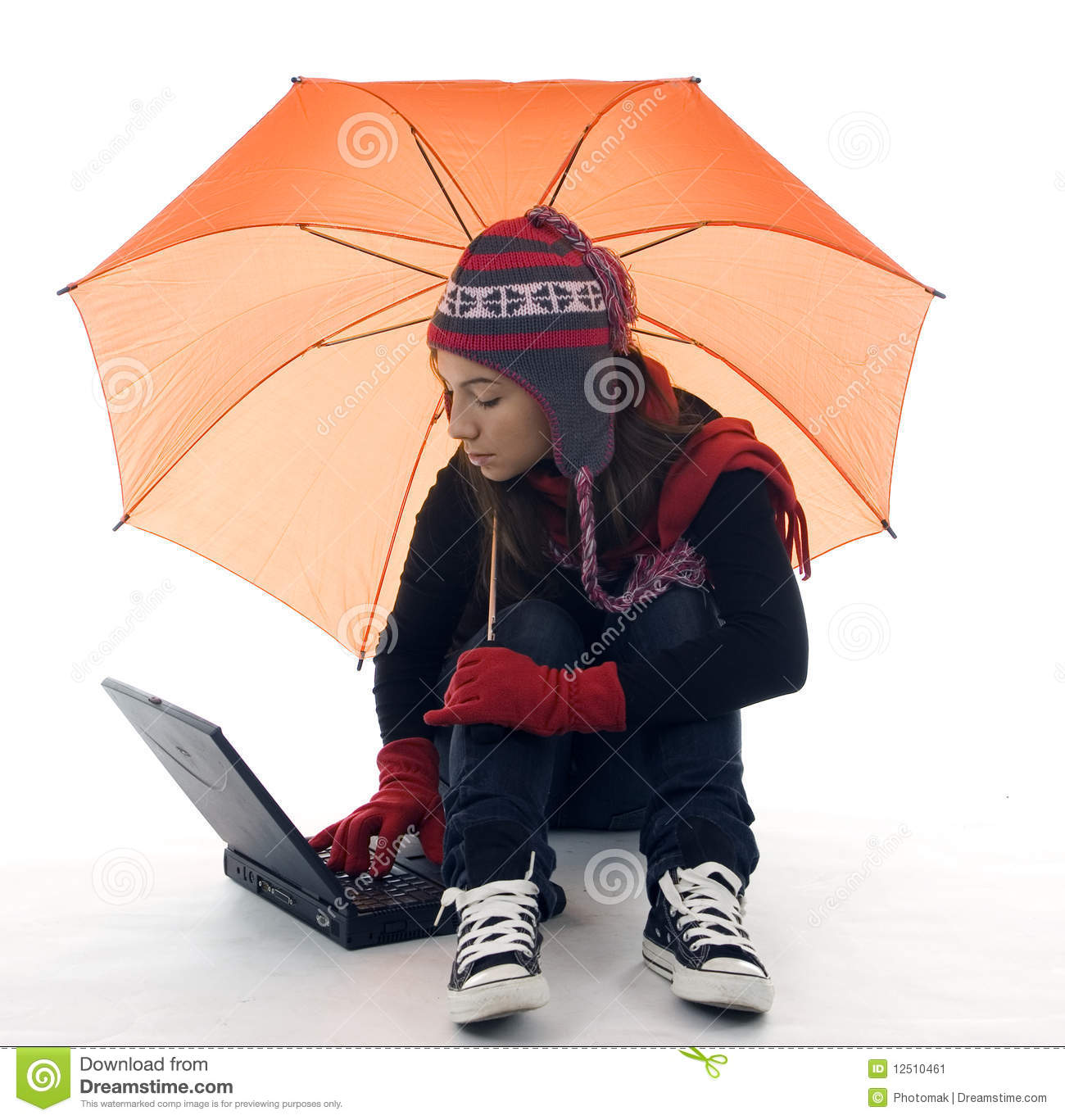 Woman In Winter Clothes With Umbrella And Laptop Stock