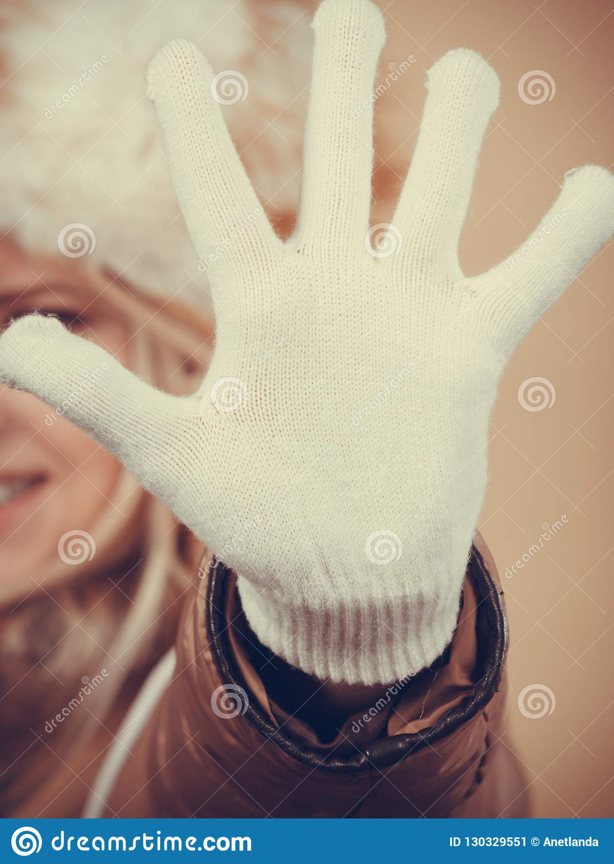 8202c565c8642 Clothing accessories, seasonal clothes concept. Woman wearing jacket, winter  furry warm hat and white gloves gesturing with hands. More similar stock  images