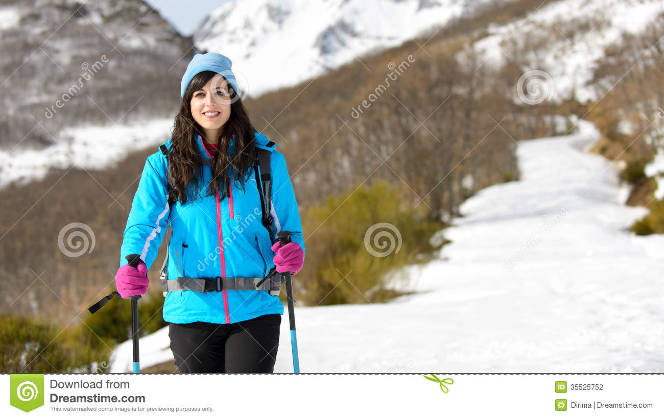 Woman Winter Hiking In Snowy Track Stock Photo - Image 35525752