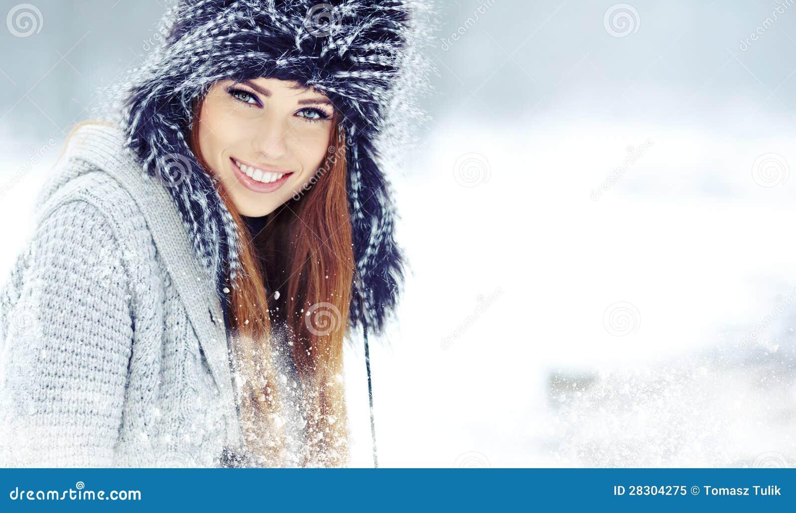 Woman winter portrait. Shallow dof.