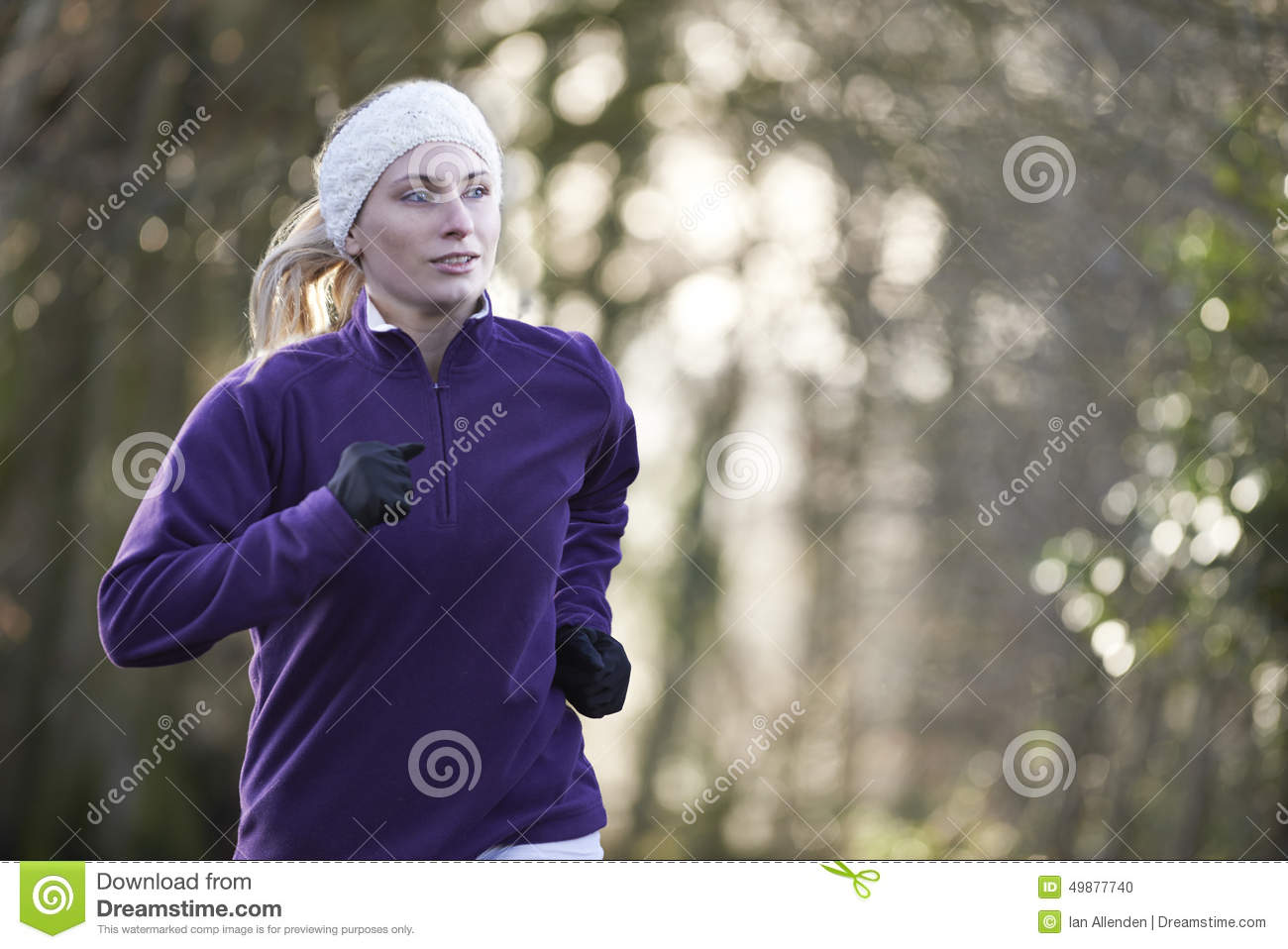 Download Woman On Winter Run Through Woodland Stock Photo - Image of pursuit, forest: 49877740