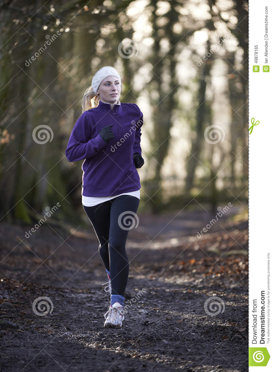Download Woman On Winter Run Through Woodland Stock Image - Image of sport, headband: 49878165