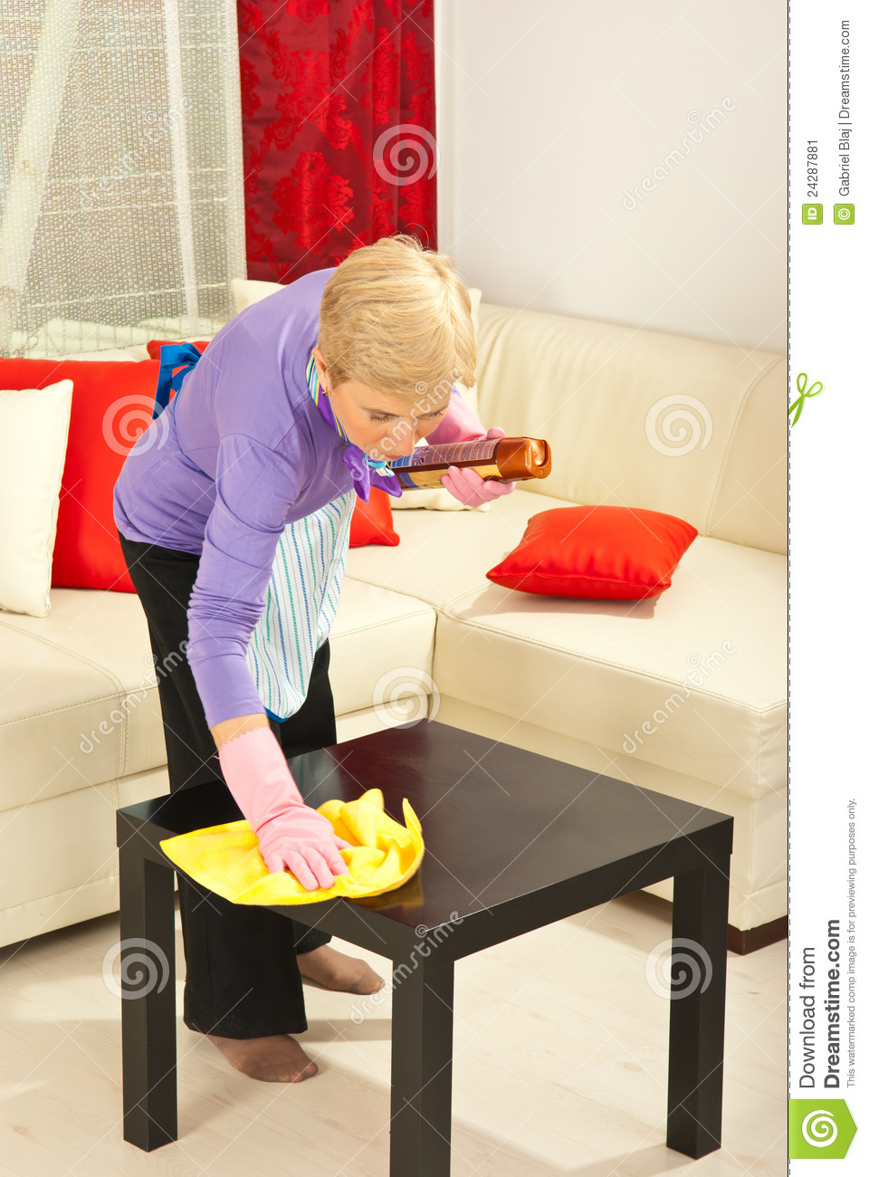 More similar stock images of ` Woman wipe dust on the table `