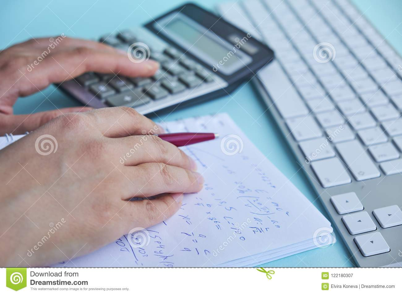 Woman Working With Calculator, Business Document And Laptop Computer