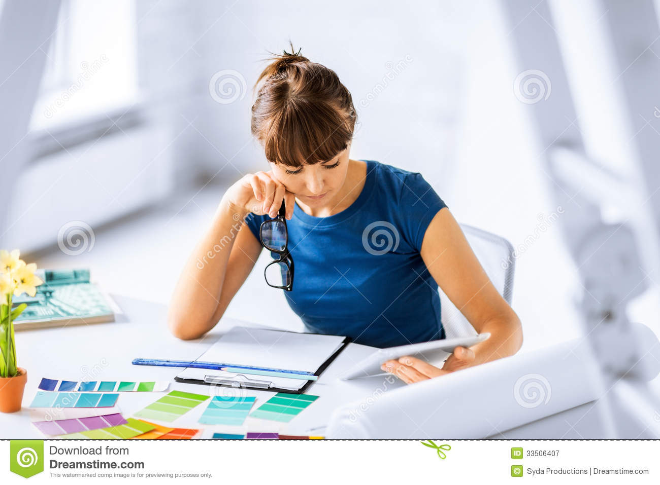 Interior Designer Working: Woman Working With Color Samples For Selection Royalty