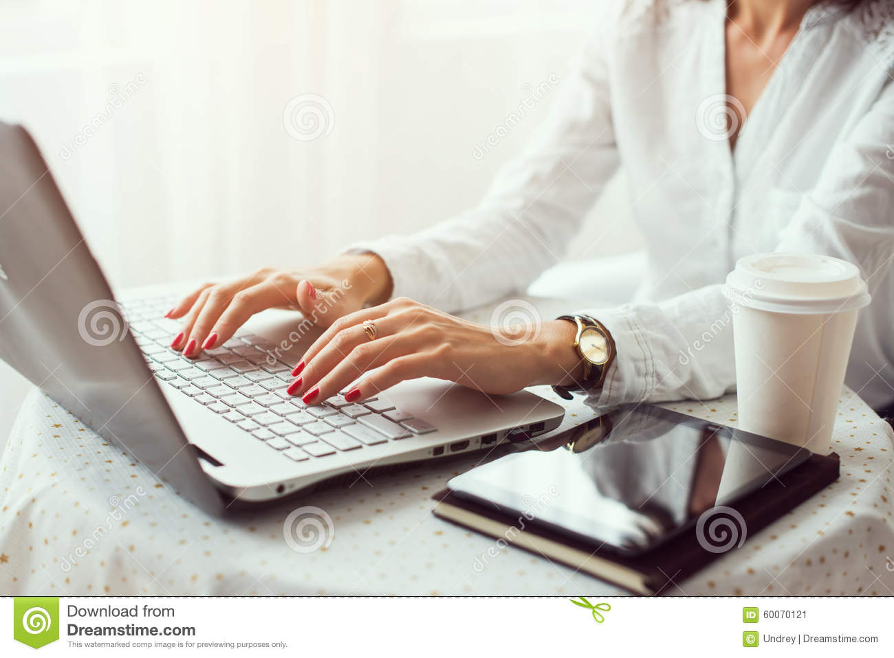 Working In Home Office woman working in home office hand on keyboard stock photo - image
