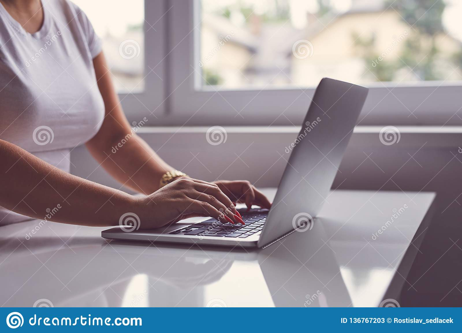 Woman working on a laptop in office