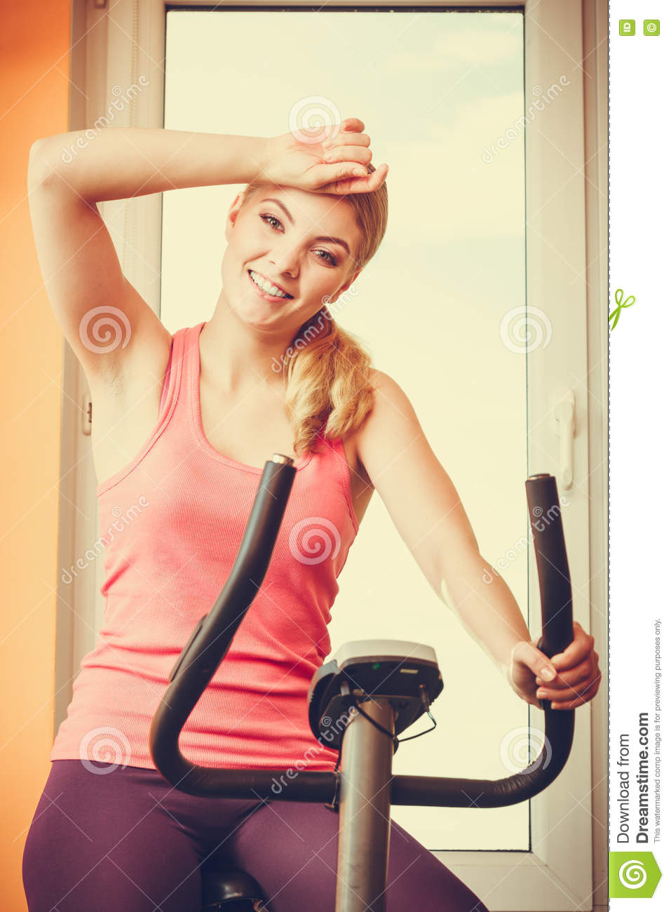 Woman Working Out On Exercise Bike  Fitness  Stock Photo