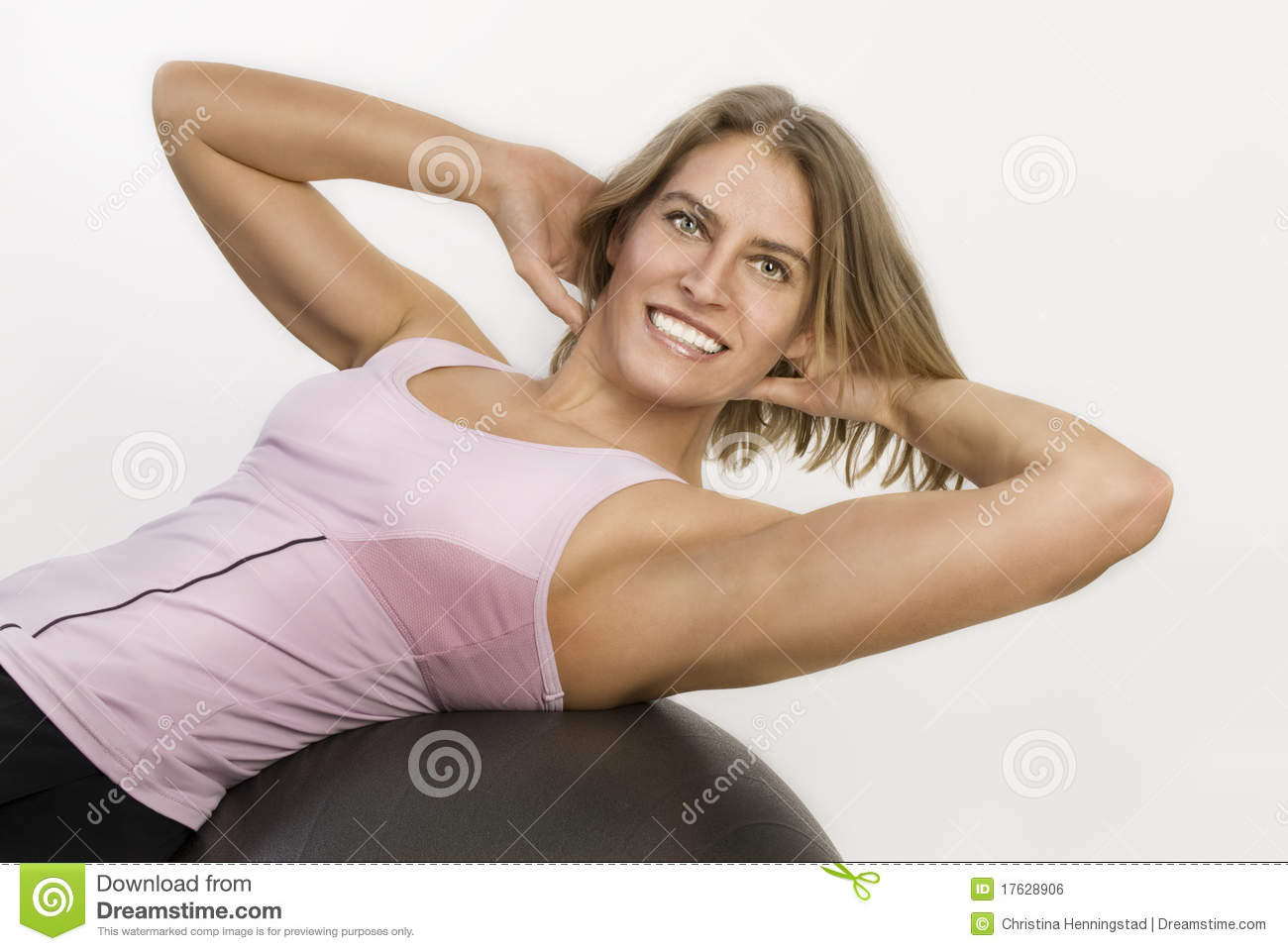 Woman working out with a gym ball