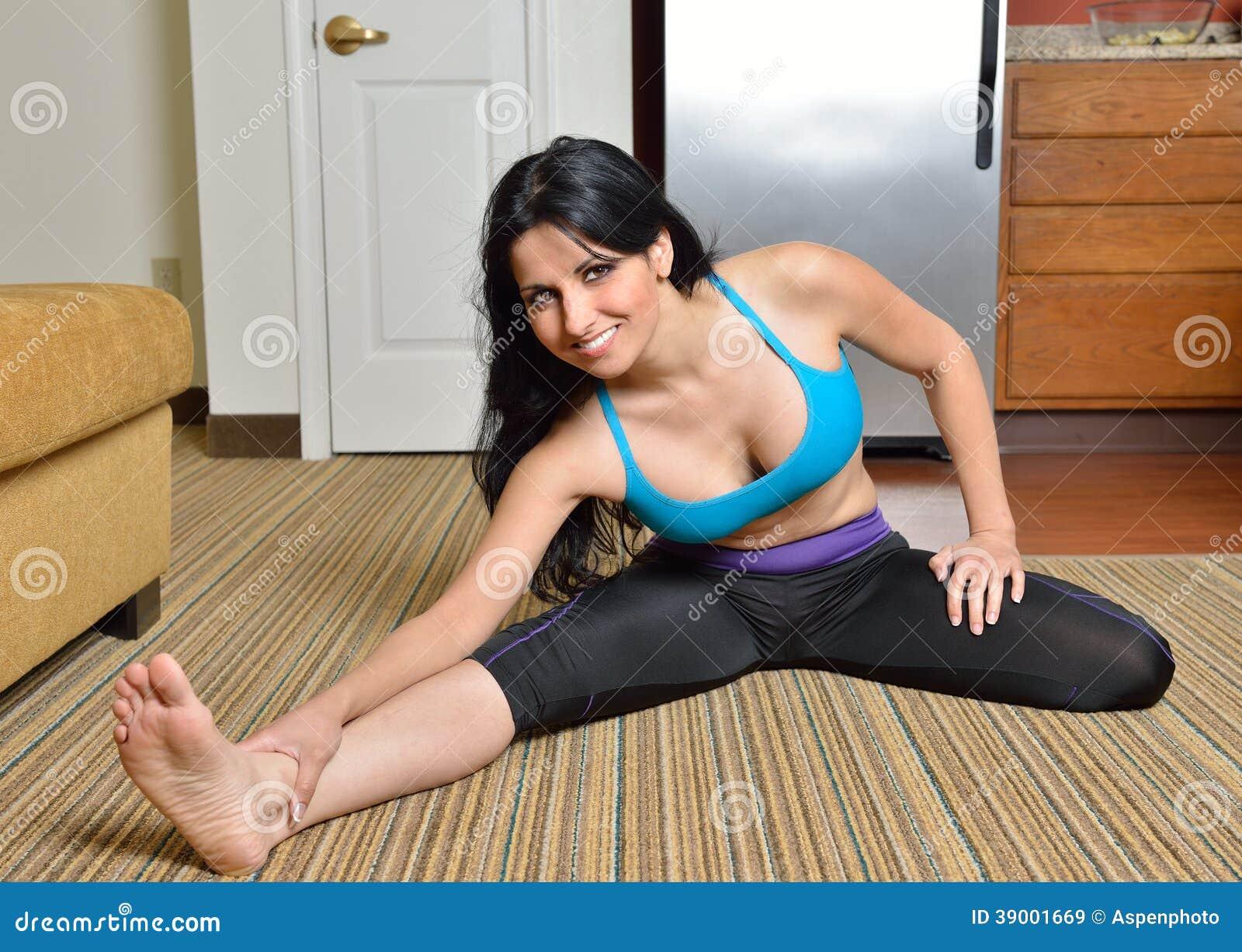 Athletic girl stretching legs on dildo 8