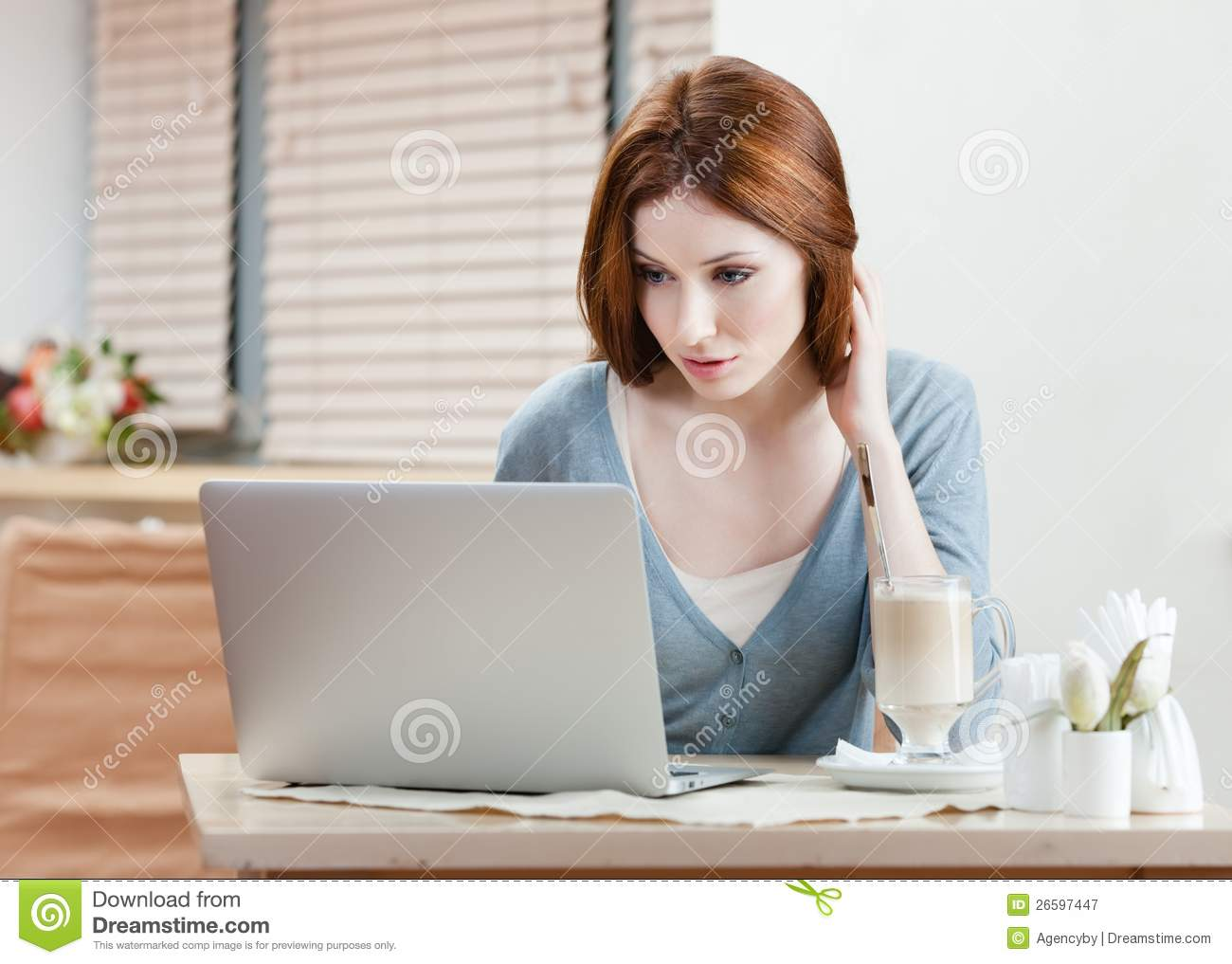 Woman is working on the pc
