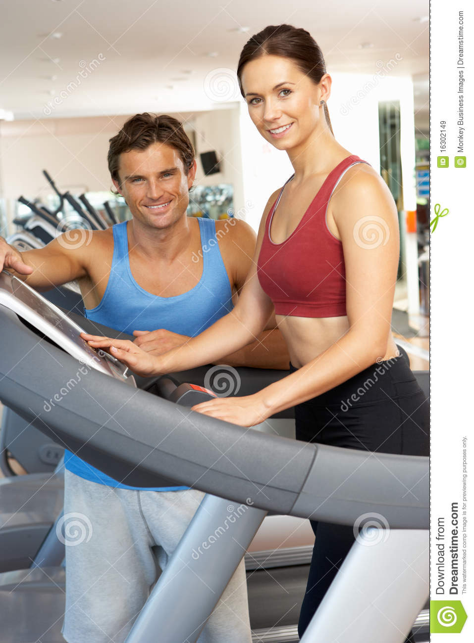 Woman Working With Personal Trainer Royalty Free Stock