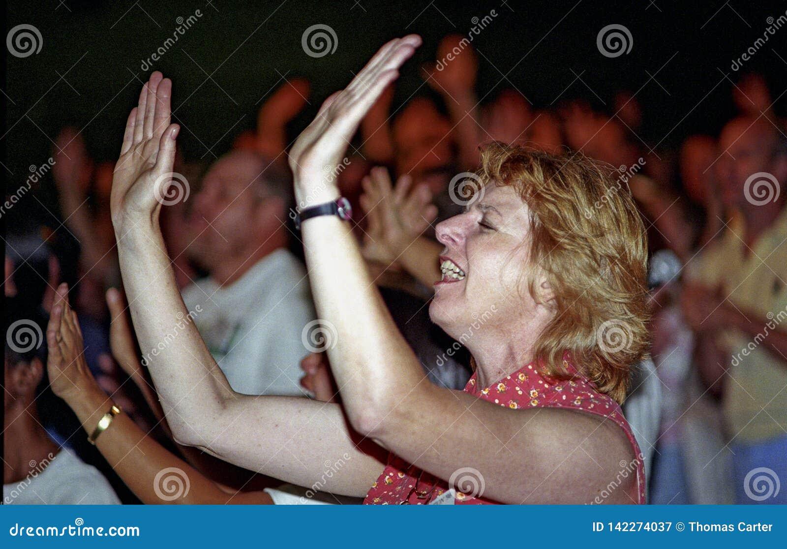 Woman worships God at a church service